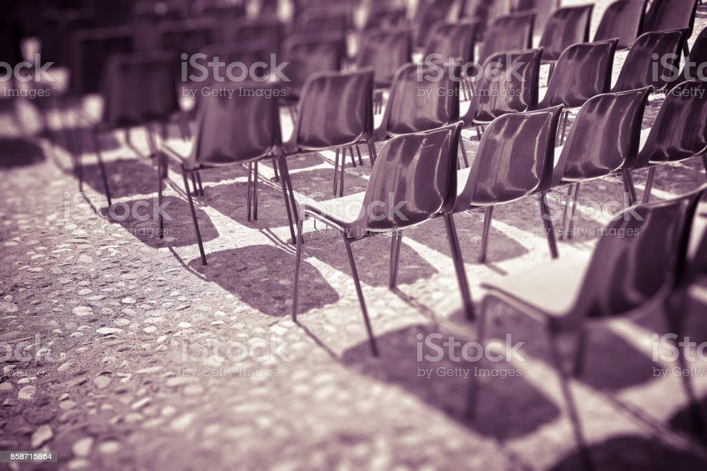 Chairs of an outdoor cinema - tilt shift filter added - toned image stock photo