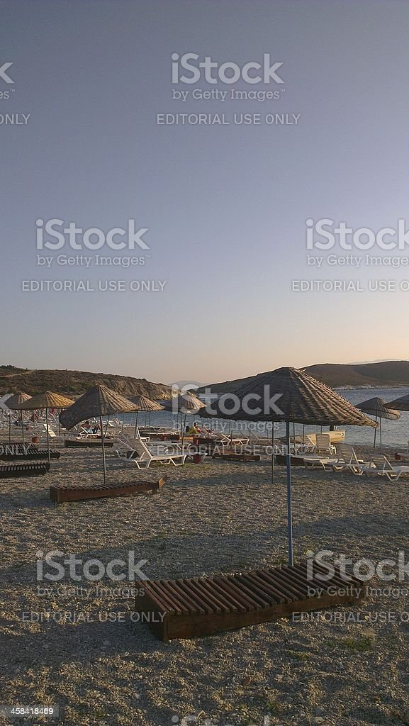 Chairs on a sandy beach in Foça, Izmir, Turkey royalty-free stock photo