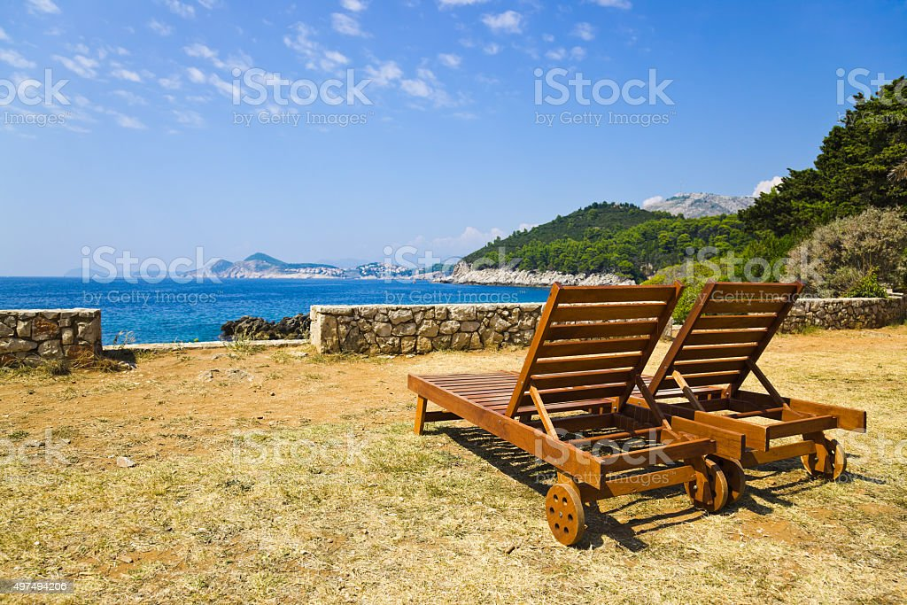 Chairs on beach at Dubrovnik, Croatia stock photo