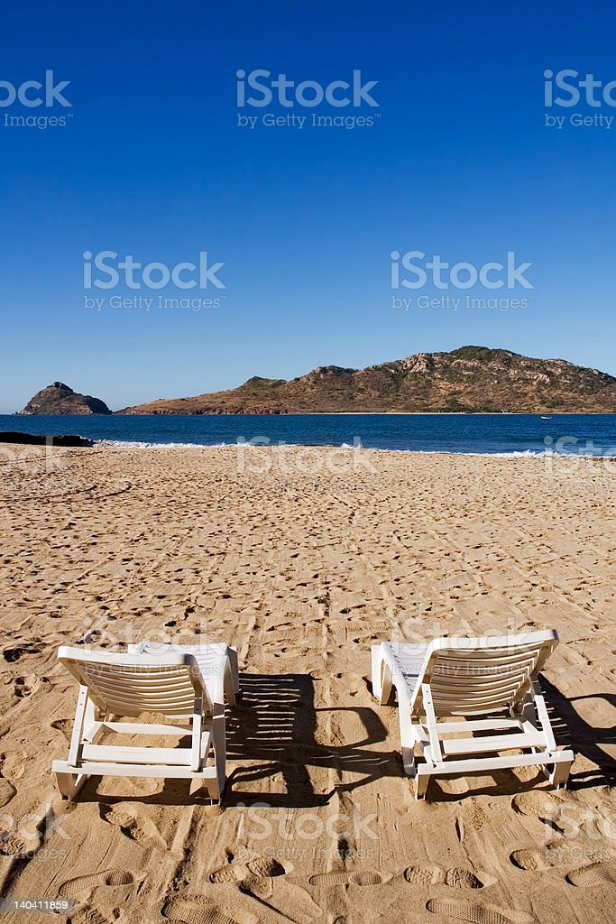 Chairs on the Beach Face Deer Island in Mazatlan Mexico stock photo