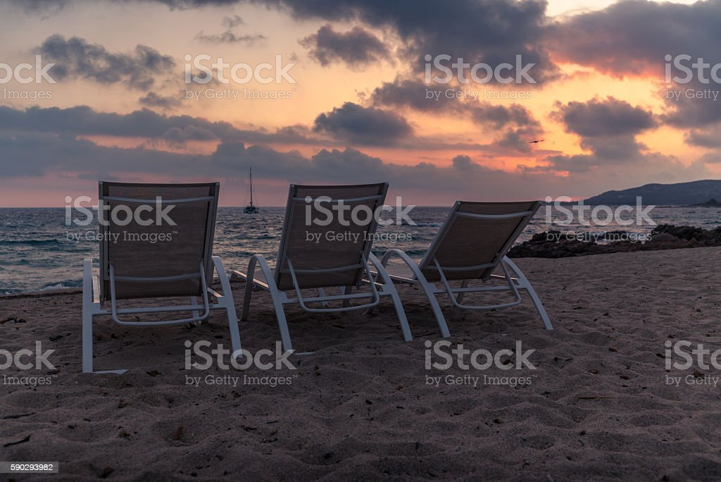 chairs on the beach in Corsica at sunset - 1 Стоковые фото Стоковая фотография