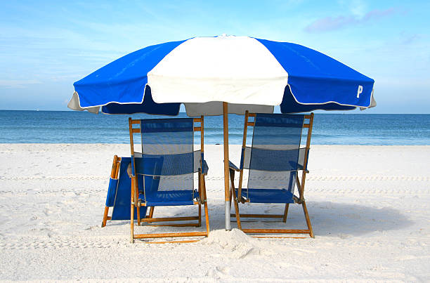 chairs on the beach - dawdle stock pictures, royalty-free photos & images
