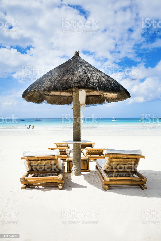 Chairs on tropical white sand beach royalty-free stock photo