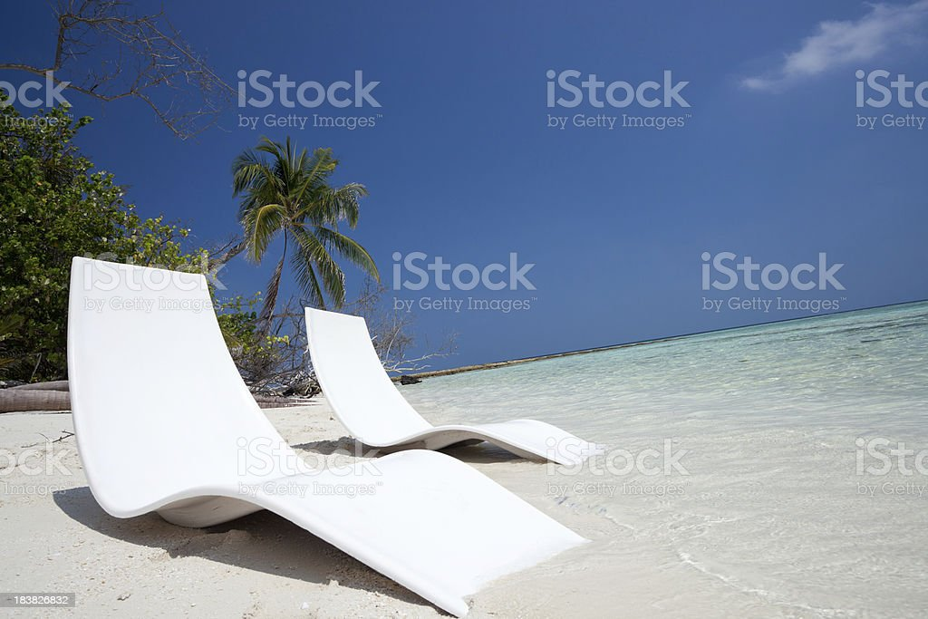 Chairs on White Beach royalty-free stock photo