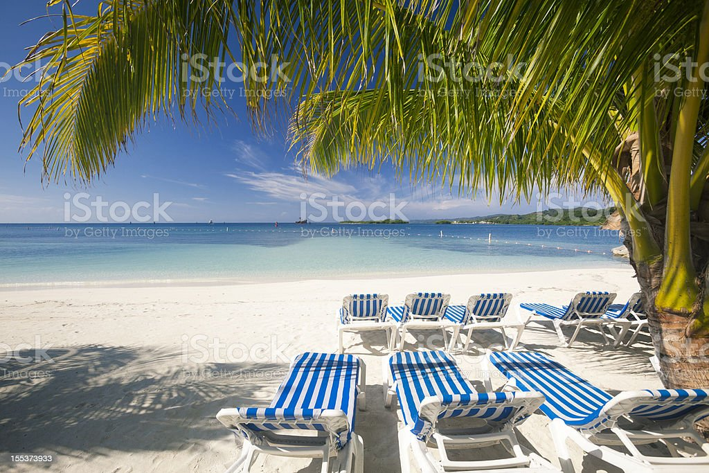 Chairs on White Sand Beach royalty-free stock photo