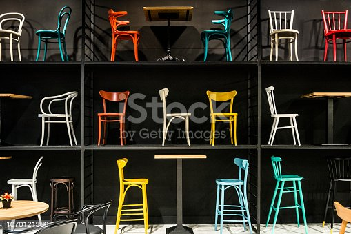 Old-fashioned wooden chairs of different colors and shapes