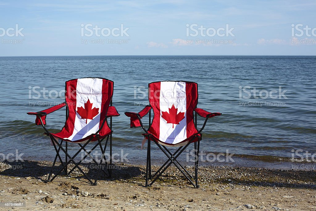 Chairs with Canadian flag by the lake stock photo
