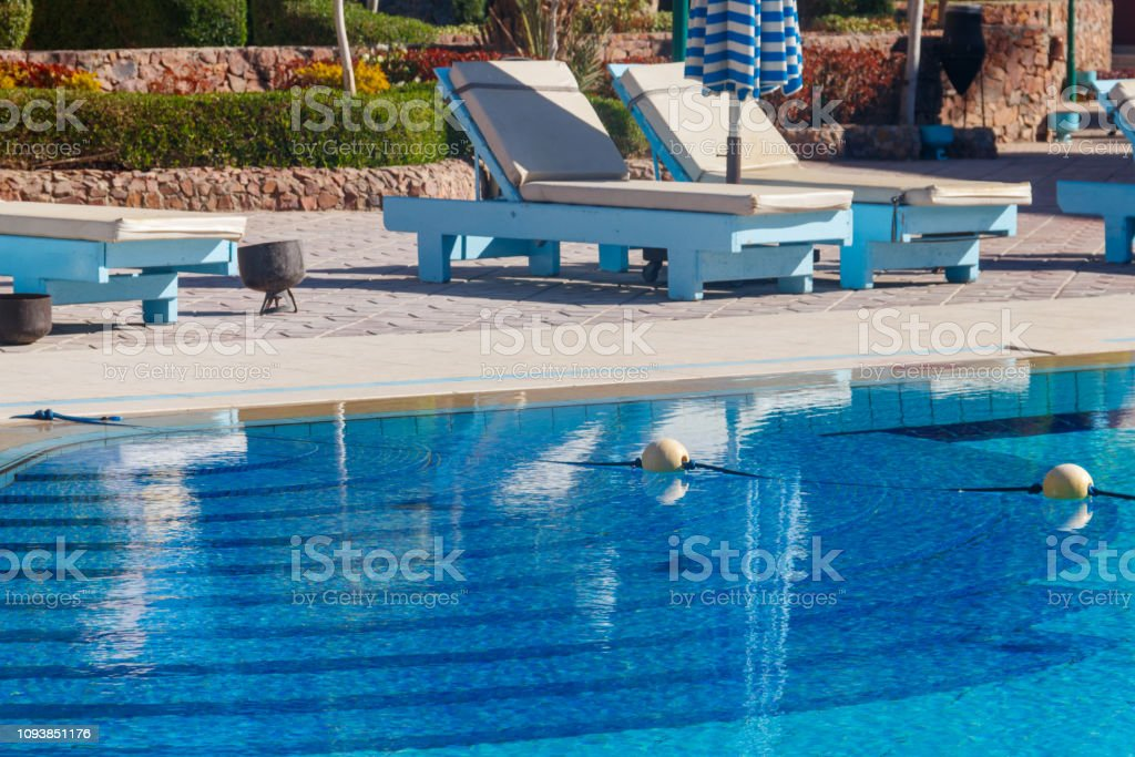 Chaise Longues Near A Swimming Pool Concept Of Spa Rest ...