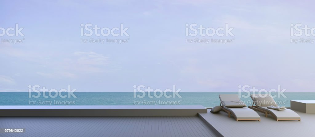 Chaise lounge on the Beach and sea in Clean sky stock photo