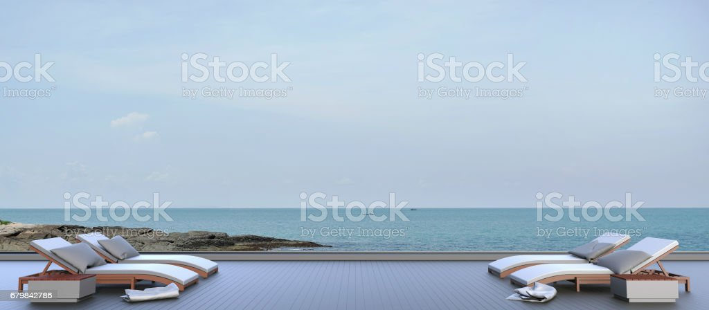 Chaise lounge outdoor on Sea view and Sky in Holiday stock photo