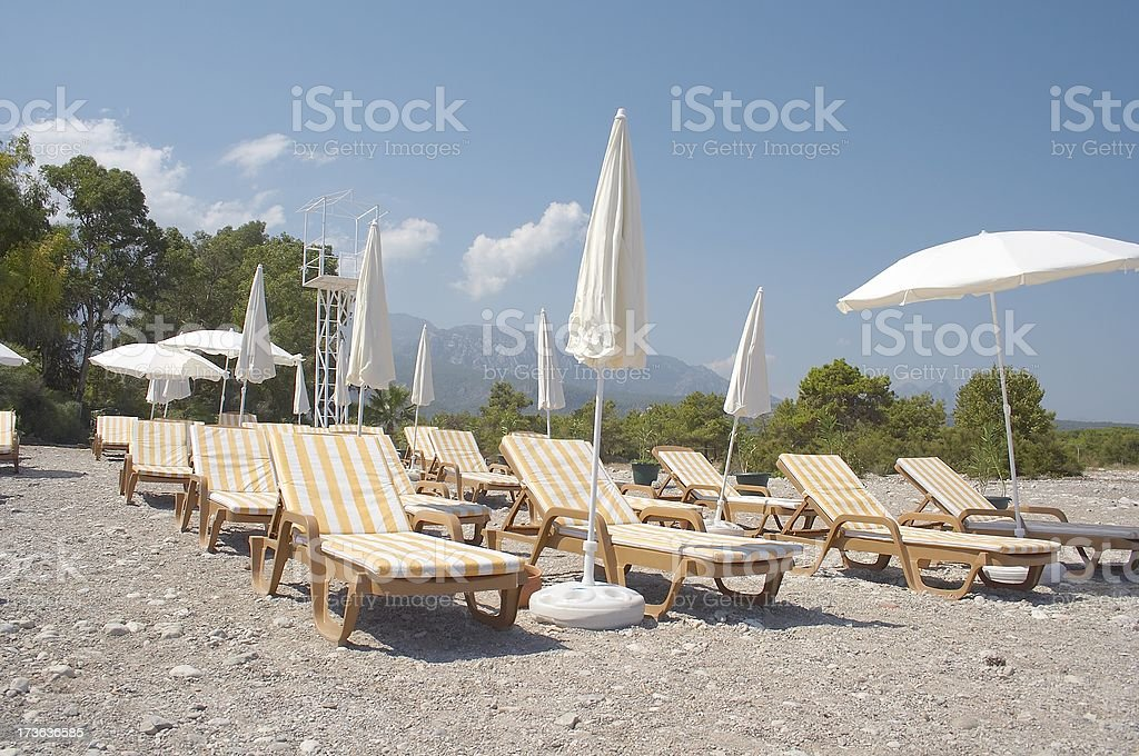 Chaiselongues on a beach. Mediterranian Sea royalty-free stock photo