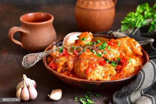 Chakhokhbili - chiken stew with cilantro (parsley) in tomato sauce in a clay bowl,traditional dish of georgian cuisine