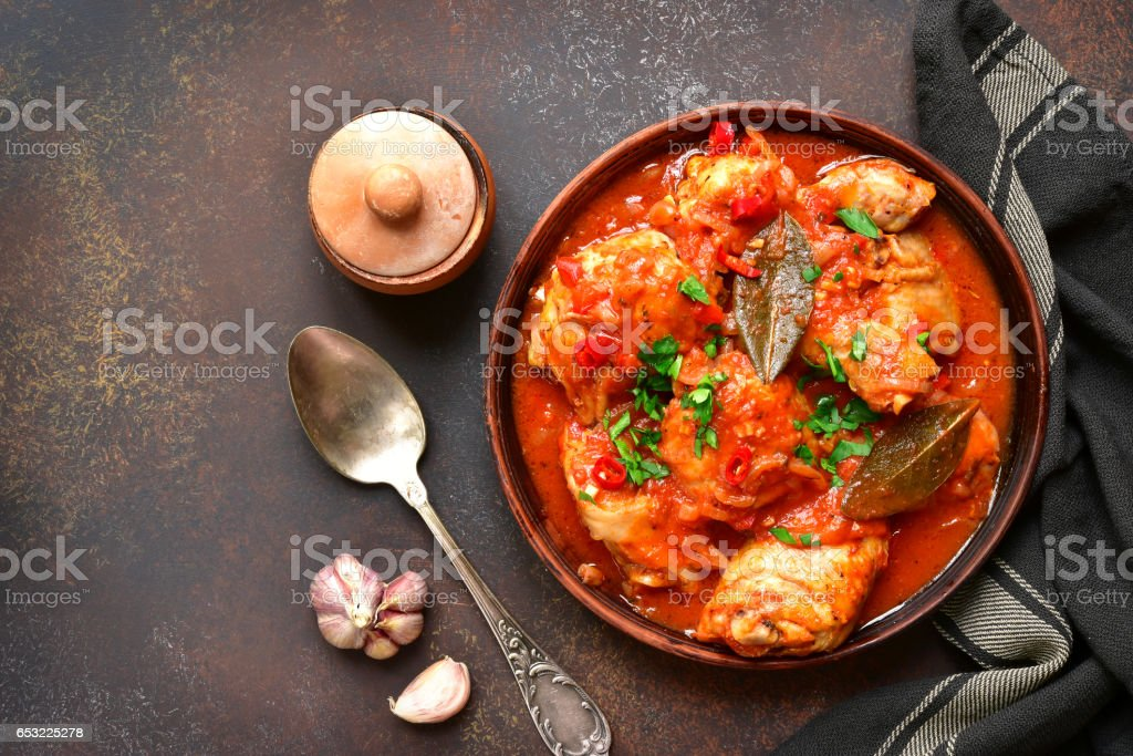 Chakhokhbili - chiken stew with cilantro (parsley) in tomato sauce stock photo