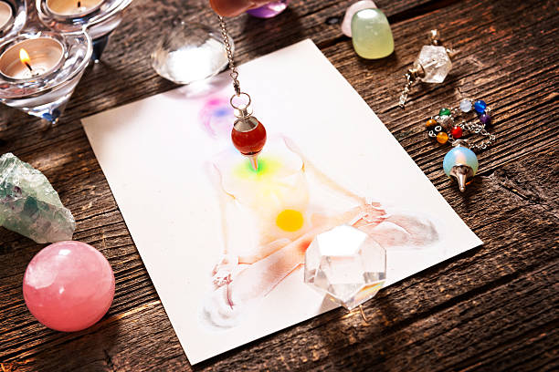 chakras over a human body - pendulum stock photos and pictures