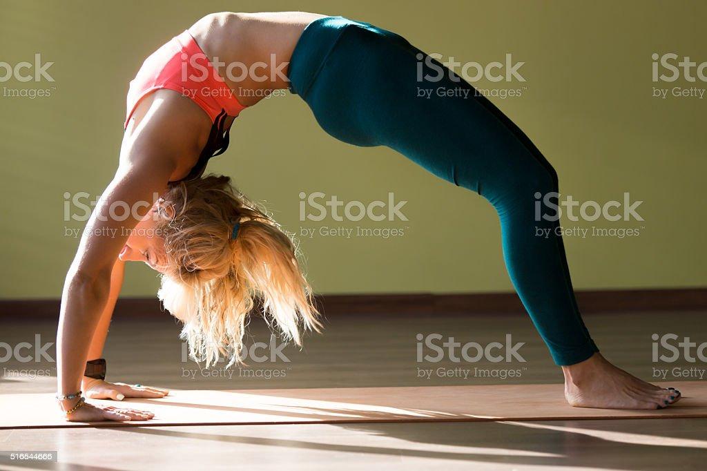 Chakrasana yoga pose stock photo