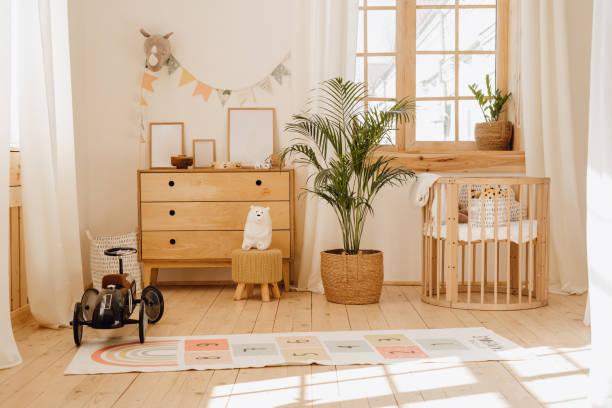 Chalet Baby Bedroom Interior with Cozy Cradle Bed stock photo