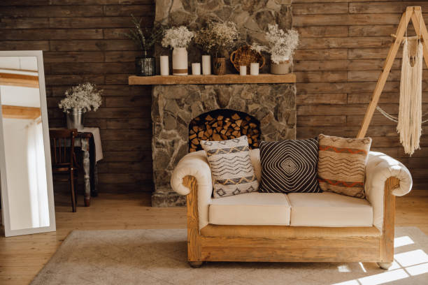Chalet Cozy Interior Wooden Sofa and Fireplace stock photo