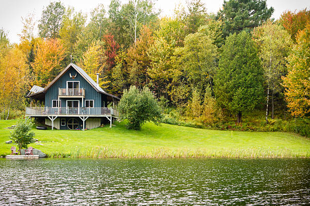 Chalet on A Private Lake With fall Trees stock photo