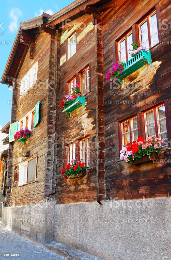 Chalet with flowers at balconies Zermatt village Switzerland in CH zbiór zdjęć royalty-free