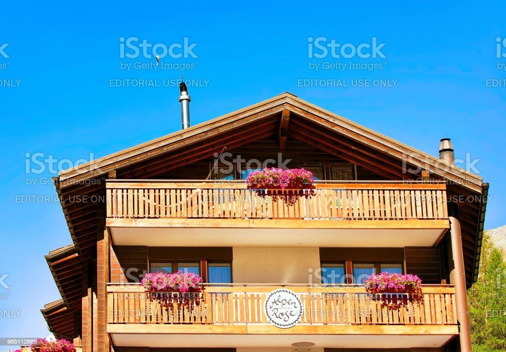 Chalet with flowers on balconies in resort city Zermatt CH royalty-free stock photo