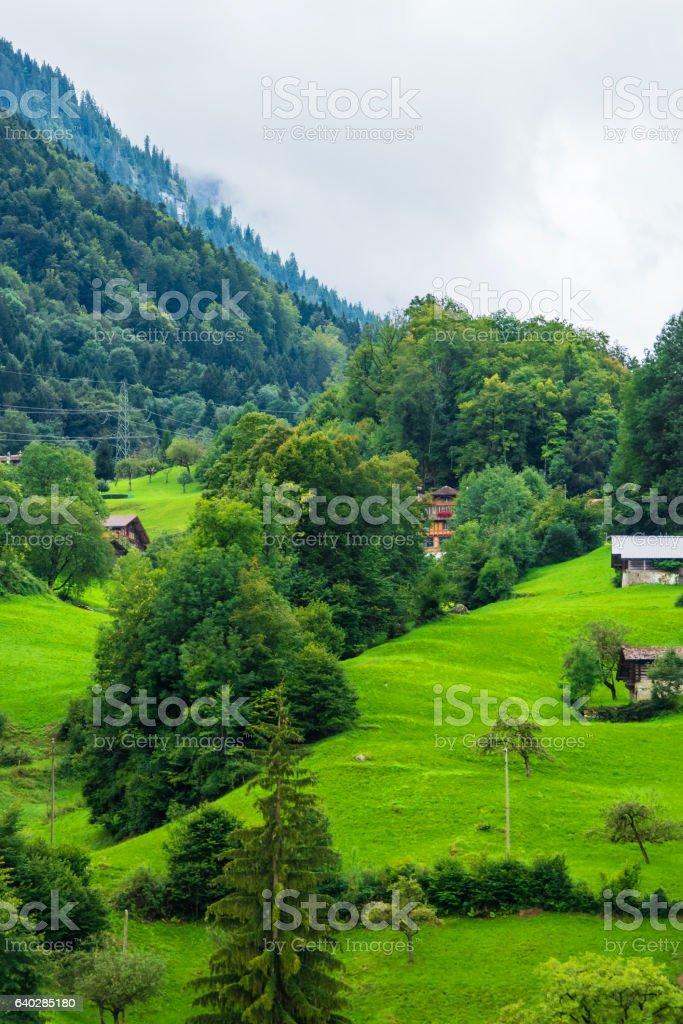 Chalets at Brienz village and Brienzer Rothorn mountain Bern Switzerland stock photo