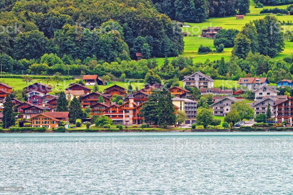 Chalets at Lake Brienz and Brienzer Rothorn mountain Bern Switzerland stock photo