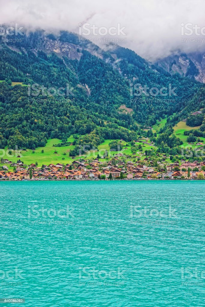 Chalets in Lake Brienz and Brienzer Rothorn mountain Bern Switzerland stock photo