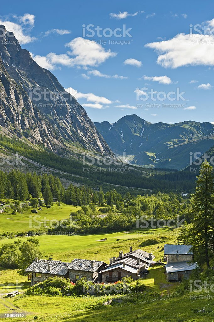 Chalets in pretty Alpine village mountain valley Italy royalty-free stock photo