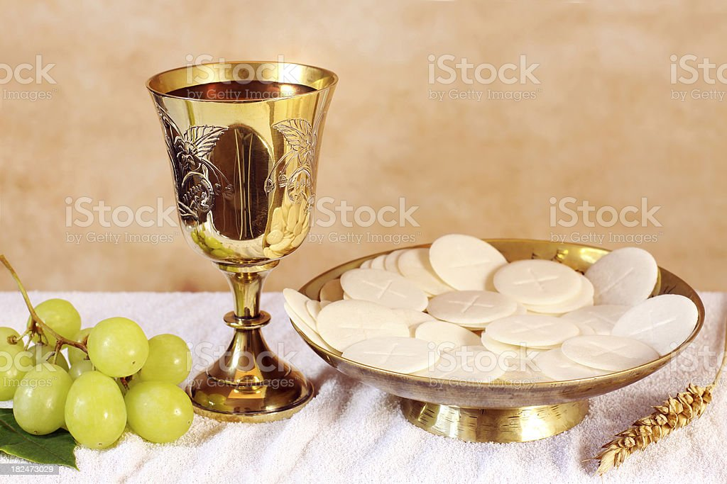 Chalice of wine and a platter with the Communion stock photo