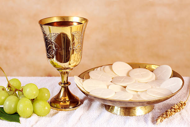 chalice of wine and a platter with the communion - communion stock photos and pictures
