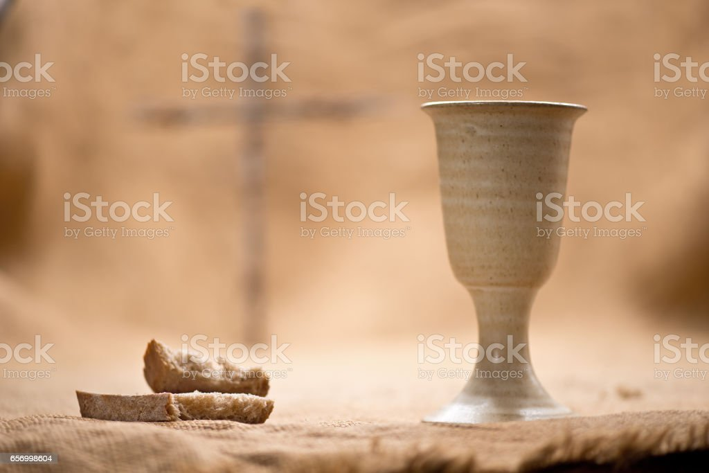 Chalice Of Wine With Bread On The Burlap stock photo