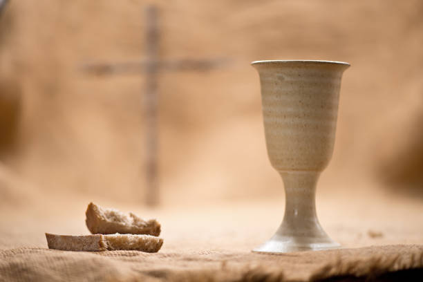 chalice of wine with bread on the burlap - communion stock photos and pictures