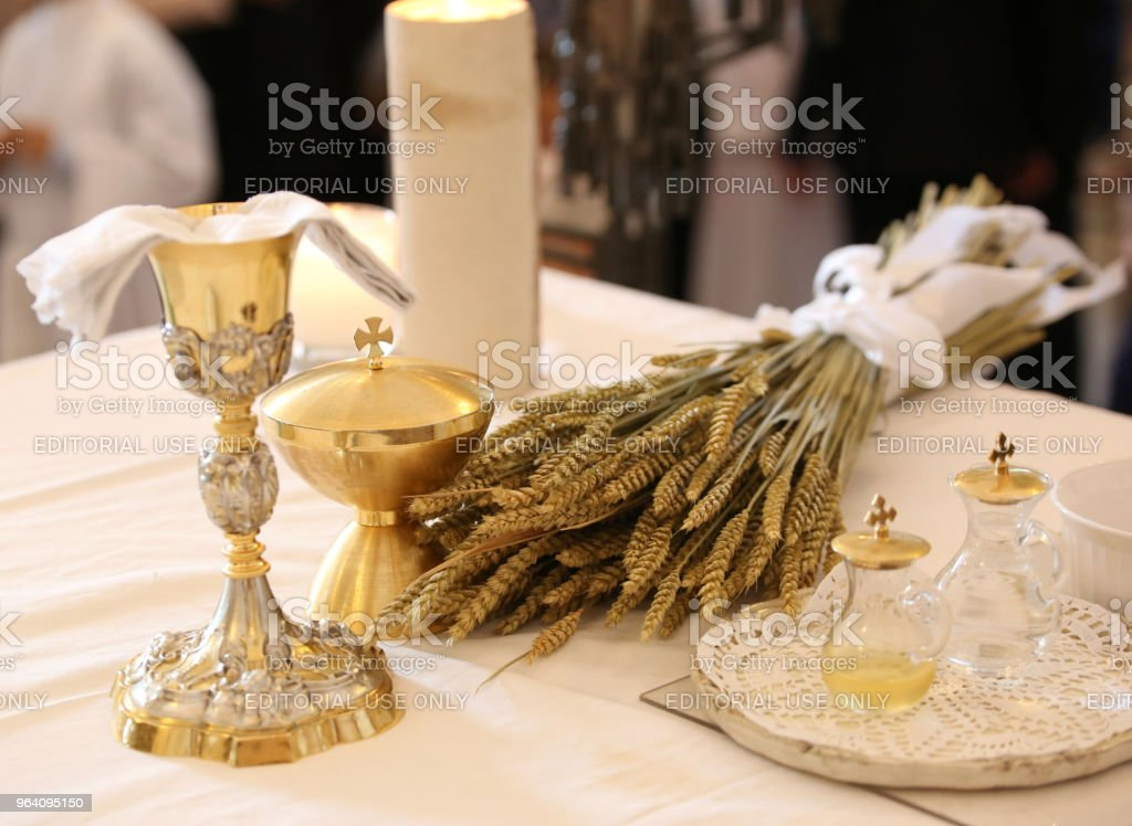 chalice on an altar in a church with ears of wheat a religious s - Royalty-free Altar Stock Photo