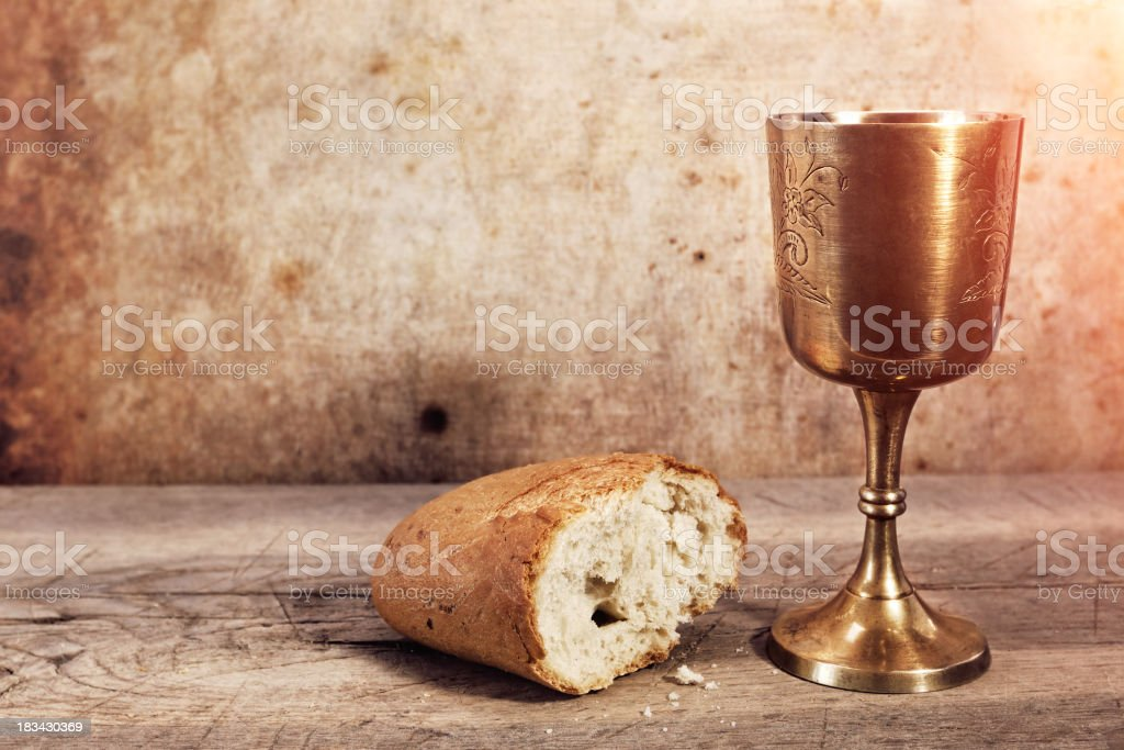 Chalice with wine and bread. stock photo