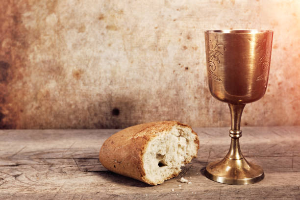 chalice with wine and bread. - communion stock pictures, royalty-free photos & images