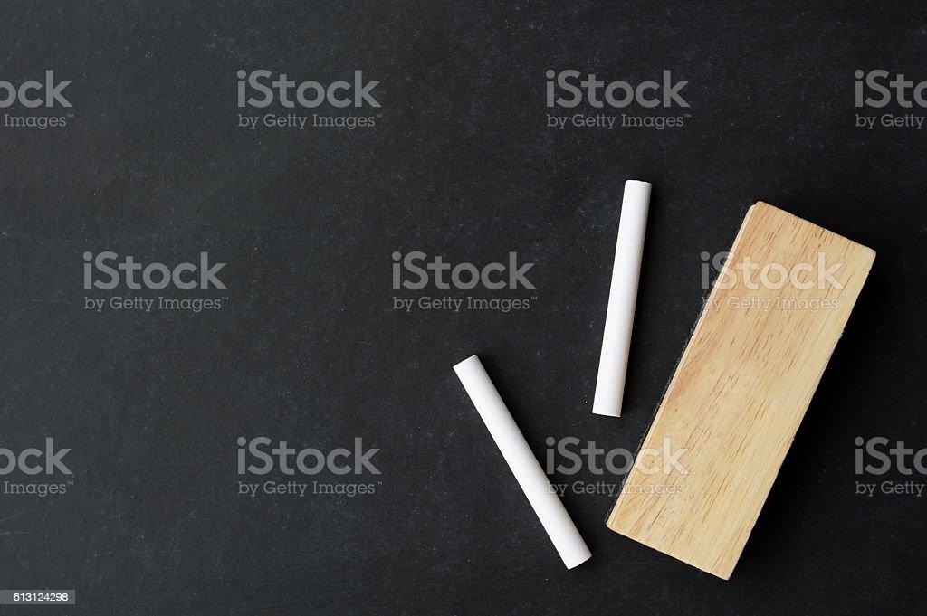 chalk and eraser on chalkboard stock photo