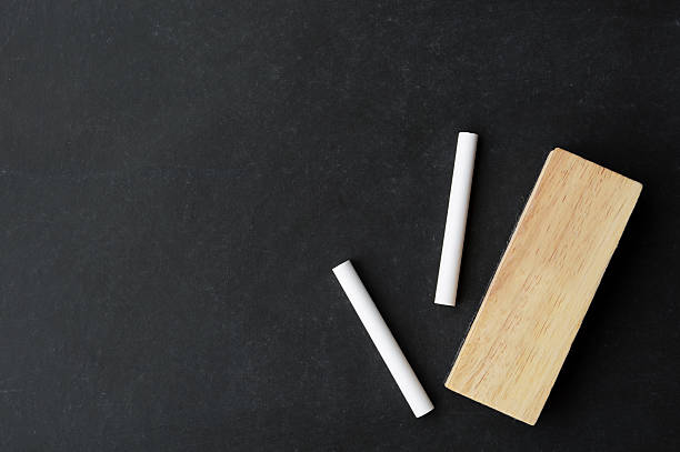 chalk and eraser on chalkboard chalk and eraser on chalkboard with copy space, ready for your message chalk art equipment stock pictures, royalty-free photos & images