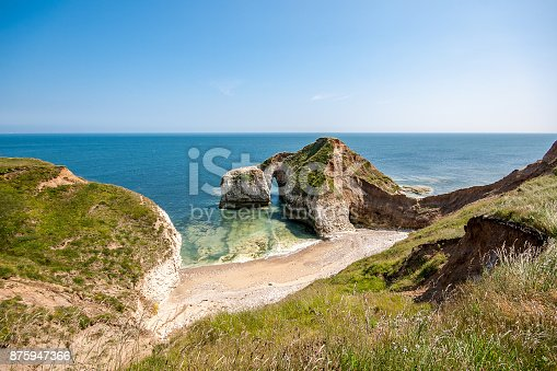 istock Chalk Arch formation on coast at Selwick Bay near Flamborough Head in Yorkshire 875947366