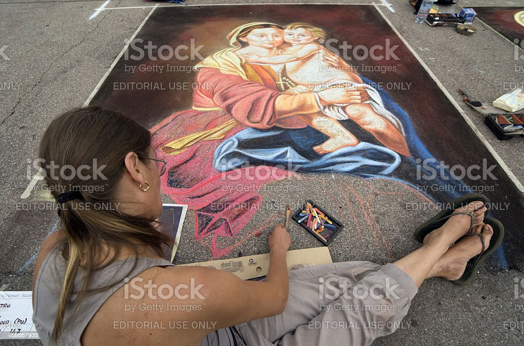 Chalk artist painting a Madonna and Child royalty-free stock photo
