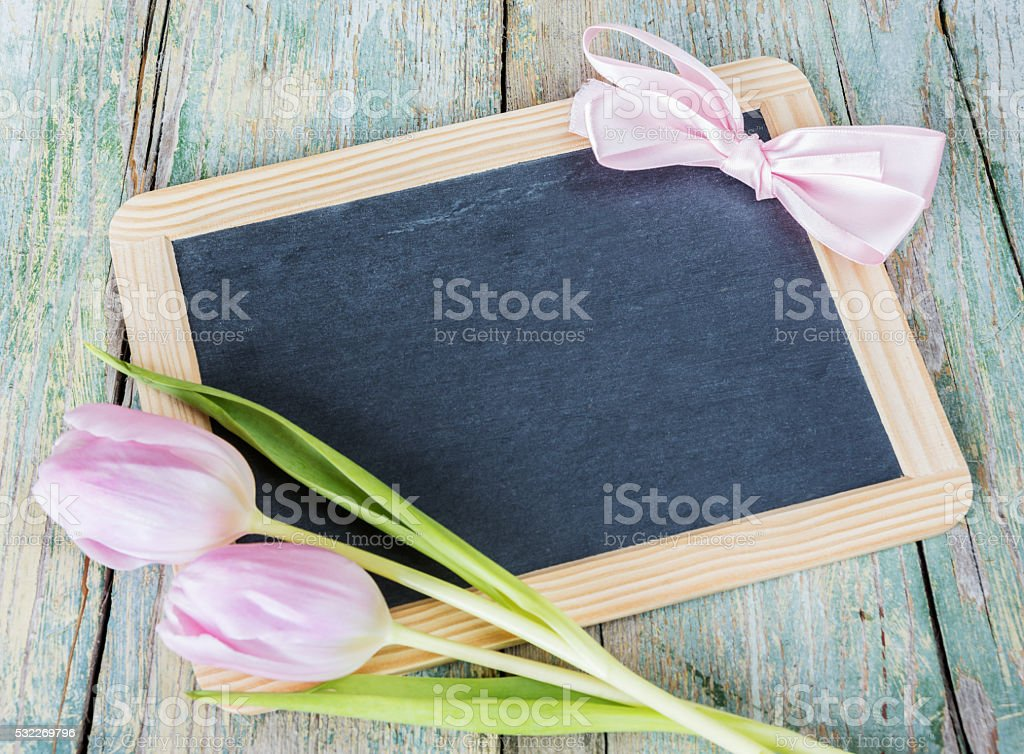 Chalk board and pink tulips stock photo