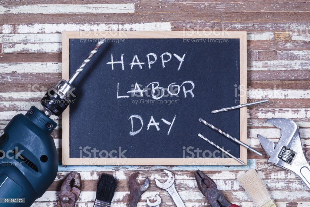 Chalk board with text HAPPY LABOR DAY with variety gruge rusty handy...