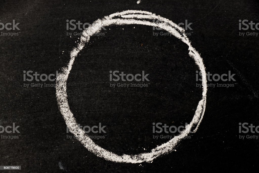 Chalk drawing as circle shape as blank stamp or seal on blackboard background stock photo
