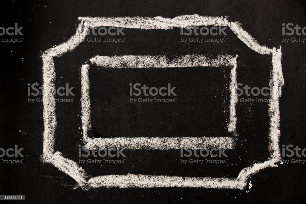 Chalk drawing as hexagon shape as blank stamp or seal on blackboard background stock photo