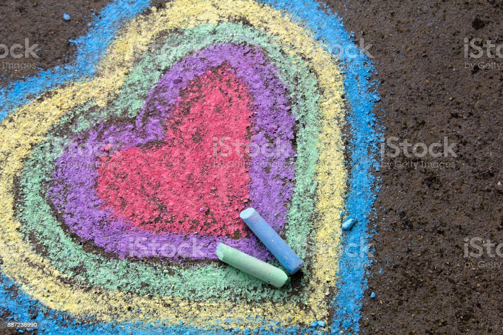chalk drawing: colorful hearts on asphalt stock photo