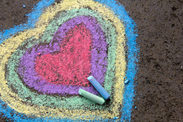 chalk drawing: colorful hearts on asphalt - foto stock