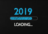 Chalk Drawing: New year 2019 loading on Blackboard. 2019 loading writes on blackboard with a chalk effect. Horizontal composition with copy space.