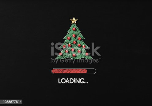Chalk Drawing: New year loading on backboard. There is a Christmas tree drawing and a loading bar on blackboard with a chalk effect.. Horizontal composition with copy space.