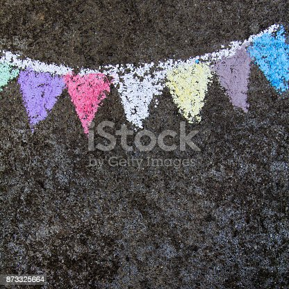 882318110 istock photo chalk drawing on asphalt: colorful  party flags or garland 873325664