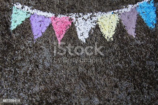 882318110 istock photo chalk drawing on asphalt: colorful  party flags or garland 887259414