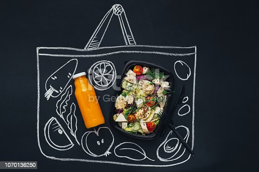 istock Chalk drawn sketch shopping bag with healthy food 1070136250
